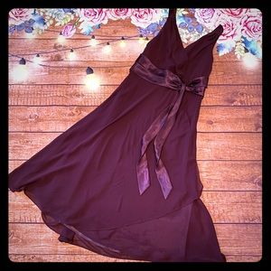 Jones wear plum bridesmaid dress